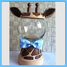 This jar can be used for a Giraffe/Safari theme Baby Shower! You wont regret the purchase.. it is simply adorable! 26 oz glass bowl. Color bow of