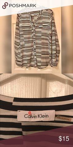 Black and White Calvin Klein Top Cute Lightweight Calvin Klein Top.  Pockets on the front, also has shoulder detailing. Calvin Klein Tops Button Down Shirts