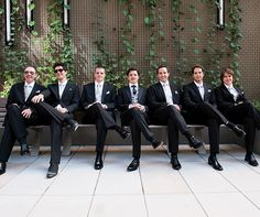 CJ's groomsmen wore crisp black suits with silver ties and pocket squares.