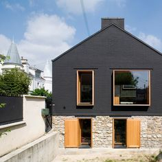 French practice Moussafir Architectes completed this refurbishment and extension of a house in the Parisian suburbs, adding deep larch wood window frames.