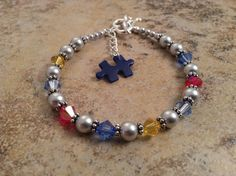 Swarovski Autism Awareness Bracelet with puzzle by CRNineDesigns, $30.00