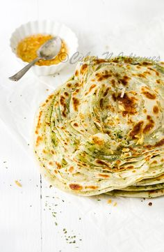 Lachcha Paratha - Multi-layered flaky flat bread flavored with garlic and mint