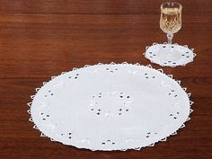 Regis Doily. A charming way to expand your view of gracious living, these handcrafted doilies of fine Italian linen spread touches of beauty throughout your home. Imported, with an array of hand embroidery and cutwork rarely found today, they have hand-faggoted loops around the edge. Available in White in a full range of sizes.  #TableLinen #Doily #schweitzerlinen