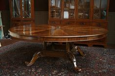 huge wooden circular dining table