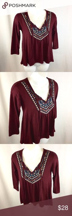 """Hollister Maroon Embroidered/Sequin Blouse This adorable blouse has been gently preloved, & is still in good condition! There is just the start of pilling, but I do not notice any major flaws. It has a pretty Embroidered design. All sequins & beading are still in place. Easy to dress up or dress down. It's made of 70% polyester & 30% viscose. The chest measures 16"""" across flat from armpit to armpit, the sleeves measure 14"""", & from the back of the collar to the bottom hem measures 22.5""""…"""