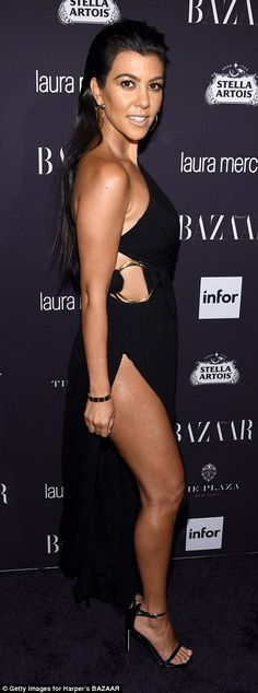 Leggy display:Kourtney Kardashian, who just returned from a yacht vacation in the South of France, showed off her trim and tanned legs in a sexy black dress which featured thigh-high slits up both legs