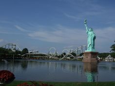 A 115 ft (35 m) high Spirit of American Independence in Heide Park Resort, a theme park in Soltau, Germany - Bizarre Replicas of the Statue of Liberty and the Eiffel Tower