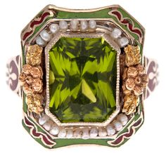 Antique peridot, enamel, and pearl ring, circa 1900 The border is surrounded by an additional layer of rusty brown and grassy green enamel. Via Diamonds in the Library. Art Nouveau