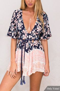 Chic playsuit featuring a multicolor floral print and a plunging V-cut neckline and selft-tie at neck. Finished with flared sleeves and cutout waistline for an adorable look. Rock this must-have on a weekend getaway for a comfortably cute ensemble!
