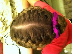 Two French braids into a bun. Common dance/figure skating hair style!