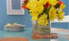 Watch How to Paint a Vase in the Better Homes and Gardens Video, using tape and glass spray for a reverse stencil etched look.
