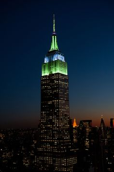 July 16, 2014: The Empire State Building shines in green and blue in honor of the Empire State Realty Trust (ESRT).
