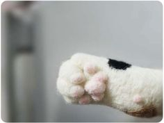 This needle felted paw is almost as adorable as the real thing!