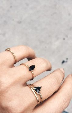 Modern dainty black & gold rings from /bingbangnyc/.