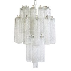 """An immaculate Mid-Century chandelier that is from Murano, Italy (circa 1960). 39.5"""" high with chain Fixture is 18.9"""" high and 13"""" in diameter Each glass is 7.5"""" high and 1.6"""" in diameter Condition: fi"""