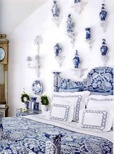 The wall of delft vases was inspired by a display of Chinese porcelain at designer Axel Vervoordt's castle.