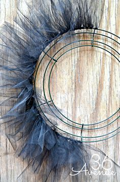 Tulle wreath tutorial. Change to frozen colors and add snowflakes instead. Cute!