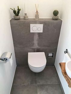 Toilet room with ceramic tiles in concrete look and fountain with wooden washbas. Toilet room with Small Toilet Design, Small Toilet Room, Guest Toilet, Downstairs Toilet, Bathroom Design Small, Bathroom Interior Design, Cloakroom Toilet Small, Wc Bathroom, Bathroom Flooring