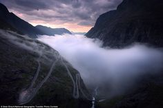 Midnight sun: A mountain road calledTrollstigen in western Norway is pictured in late summer just as a dense fog rolls in during the midnight sun