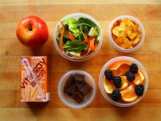 garden-of-vegan:  Gala apple, green salad (spinach, butter lettuce, carrot ribbons, and cucumber), spicy plantain chips, Vitasoy malt soy milk, dark chocolate, tangelo orange and blackberries.