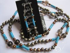 Olive Green and Gold Pearls Turquoise Tubes and Beads, 10 mm Smokey Quartz Beads, Sterling Silver Spacers with Luxury Silver tone Ball Clasp – Our model is wearing two strands of the King Tut … Jewelry King, Pearl Jewelry, Gemstone Jewelry, Sterling Jewelry, Sterling Silver, Long Pearl Necklaces, Smokey Quartz, Gold Pearl, Turquoise Jewelry