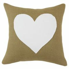 "Burlap pillow with a white heart detail.   Product: PillowConstruction Material: Burlap coverColor: Natural and whiteFeatures: Insert includedDimensions: 17"" x 17""Cleaning and Care: Spot clean"