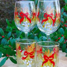 Mistletoe with Red Bows, hand painted stemware for Christmas celebrations.