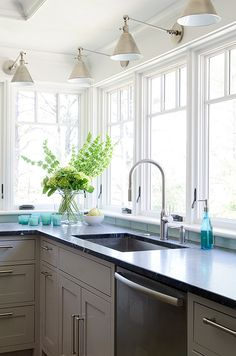 Grey kitchen with turquoise accents. Grey kitchen with turquoise decor. #GreyKitchen #Turquoise #DecorKristina Crestin Design.