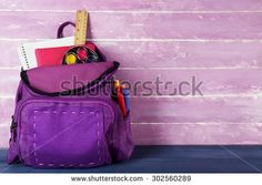 School backpack on wooden background - stock photo