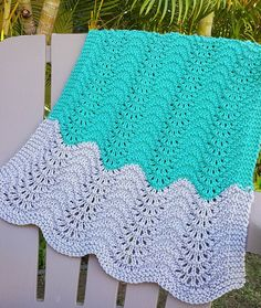 Free Knitting Pattern for Feather and Fan Car Seat Baby Blanket - Easy 4-row repeat lace baby blanket that's great from stripes and using up stash yarn. Length: 29 inches Width: 19 inches. Designed by Linda Ann Ball. Pictured project by tanyakitty
