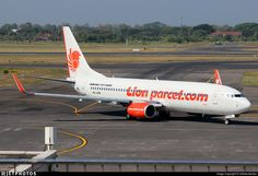 Lion Air (ID) Boeing 737-8GP PK-LPM aircraft, painted in ''Lionparcel.com'' special colors, rolling to gate at Indonesia, Juanda Int'l Airport. 24/08/2017.