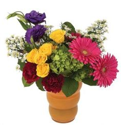 A kaleidoscope of colourful blooms in a bright orange vase. A contemporary design of gerbera, hydrangea, lysianthus and more. Gerbera, Laugh Out Loud, Hydrangea, Provence, Contemporary Design, Floral Arrangements, Centerpieces, Bloom, Bright