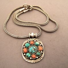 """Silver, turquoises, corals, Tibet   Description  A nice little old pendant which shows once more the secular taste of Tibetan people for coral and turquoise ...  Weight:15,5gr    Height:1,25inch    Width:0,94 inch    www.halter-ethnic.com...see """"My Lucky Finds"""""""