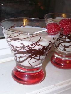 White Chocolate Martini        (1 1/2 shots Godiva White Chocolate Liqueur   1 1/2 shots half-and-half   1/2 shot vodka   Nonpareils   Light corn syrup   1 oz Vanilla Vodka   1 oz White Chocolate Liqueur)