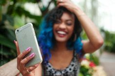 A young woman taking a self portrait with a mobile cell phone by Chelsea Victoria - Woman, African american - Stocksy United Justin Photos, Chelsea Victoria, Phone Photography, Used Iphone, Young Women, Take That, African, The Unit, Stock Photos