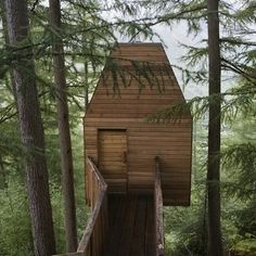Art Studio:  While many DIY tree houses offer charm in their haphazard and piece-meal construction, this beauty stands out for the meticulous attention to detail in its design. Surrounded by the chaos of irregular tree branches, this sleek outdoor haven provides a calming environment for the art studio it houses inside.