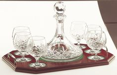 Galway Crystal - Longford Brandy Decanter Tray Set  Galway Crystal has long been established as one of the worlds best known and loved brands of traditionally crafted crystal. Manufactured in the heart of the West of Ireland, on the shores of Galway Bay, Galway Crystal is steeped in the rich and diverse heritage of this unique and historic land.  Today!  Galway Crystal is the gift of choice for weddings, anniversaries, military promotions, military retiremets and indeed for all special…