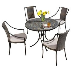 Enjoy a poolside barbecue or weekend brunch on the patio with this charming indoor/outdoor dining set, featuring 4 woven arm chairs and a bistro table with a...