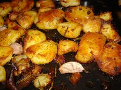 jamie oliver's roast potatoes Just with olive oil, rosemary and garlic its delicious...