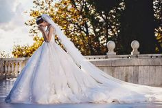 Real bride in a gorgeous Michael Cinco wedding dress – timeless and stunning! Cathedral-Monarch Train.