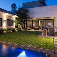 Jardins modernos por Rousseau Arquitectos