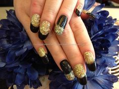 Acrylic nails with glitter dust and black gel polish