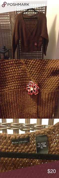 Gorgeous Coppery Brown Crossover Sweater Gorgeous coppery brown colored sweater is in great shape! I only wore it once because I lost the broach that came with it and threw it in the closet. As seen in picture, I have added a beautiful broach for you, which will be included at no additional cost with purchase. 70% Acrylic, 30% Wool. Moda International Sweaters Cardigans