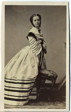 c1860s - unknown lady leaning on a chair civil war era fashion