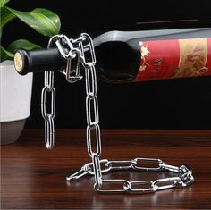 Aliexpress.com : Buy New Magical Suspension Wine Bottle Rack Holder Metal Chain Silk Ribbon Suspended Line Product Bar KTV Fashion Shelf Decoration from Reliable shelf fitting suppliers on Handicraftsman