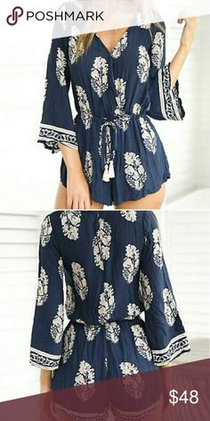 Lovely Boho cotton blend feather summer romper Very pretty figure flattering v neckline, cross front with adjustable tie waist, navy and white soft cotton blend fabric with distinct feather and ethnic pattern. Hidden tie waist with tassels. Boho, romper playsuit. Pants Jumpsuits & Rompers