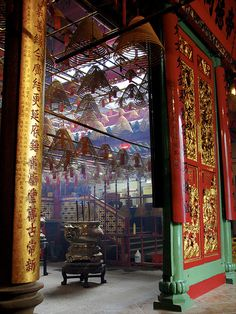 Although it is not the most imposing of Hong Kong's temples, Man Mo Temple is full of ambiance and character and is well worth visiting...     Entrance | Man Mo Temple Hong Kong by Static Kitten, via Flickr