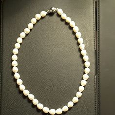 Pearl necklace w/appraisal $690 NWOT ⤵💲 ~~Beautiful white freshwater pearl necklace. Push pin clasp. 10 yrs to grow!! ~~Appraised Value:  $690.00 ~~3rd Party Appraisal Included! ~~Item Type:  Pearl Necklace ~~Total Weight:  49.30 Grams ~~Metal:  925 Silver Chain Lock  ~~Gemstone:  Pearl ~~Pearl Size:  8.50 to 9.50 mm diameter ~~Color:  White ~~Shape/Uniformity:  Baroque/Good ~~Luster/Nacre:  Medium/Thick ~~Necklace Length:  17 inches long  ~~Condition:  New w appraisal, no store tags were…