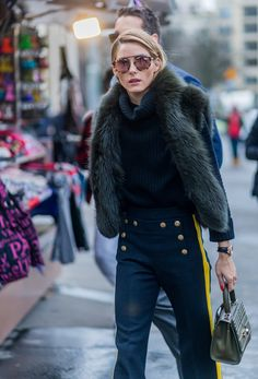 Olivia Palermo wore bold pants and an emerald fur stole.