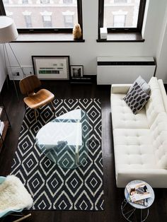 Minimal living room interior design -- @David Rodriguez idea for two mixed chairs in living room